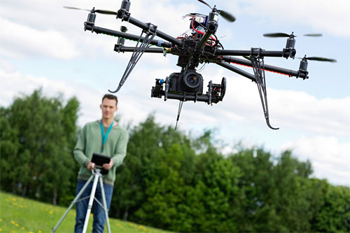 Technician Operating UAV Octocopter